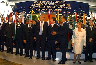 "Castro with South American leaders of the Mercosur trade bloc in 2006. In the 2000s Castro forged alliances in the Latin American ""pink tide"". XXX Cumbre del Mercosur - Cordoba - 21JUL06 -2- presidenciagovar..jpg"