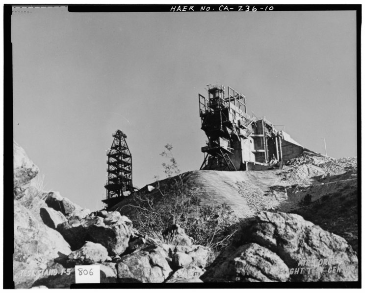 "File:""TEST STAND 1-5, AIR FORCE FLIGHT TEST CENTER."" ca. 1958. Test Area 1-115. Original is a color print, showing Test Stand 1-5 from below, also showing the HAER CAL,15-BORON.V,4-10.tif"