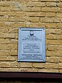 Табличка на будинку колишньої жіночої гімназії, Чернігів.jpg