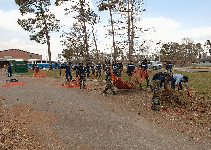 File:050909-N-4374S-009 U.S. Navy sailors assigned to the amphibious assault ship USS Bataan (LHD-5) and Mexican marines as they remove debris at D'iberville Elementary School, in support of Hurricane Katrina relief efforts.jpg