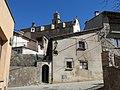 079 Cal Corona, c. Major 1 (Sant Boi de Lluçanès), al fons l'església parroquial.jpg