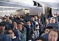 110312-F-NW653-143 Passengers aboard a Delta Air Lines flight.jpg