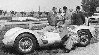 Medardo Fantuzzi - Medardo fixing a Maserati Tipo 61.