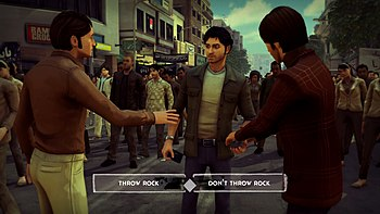"The player character is standing with a rock in his hand, with two friends in front of him and a large crowd behind him. There are two dialogue options near the bottom of the screen: ""Throw Rock"" and ""Don't Throw Rock""."