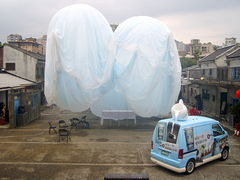 A giant floating cloud by The XRANGE Studio and a Starbucks Coffee Car by Uni-President Corporation.Image: Rico Shen.