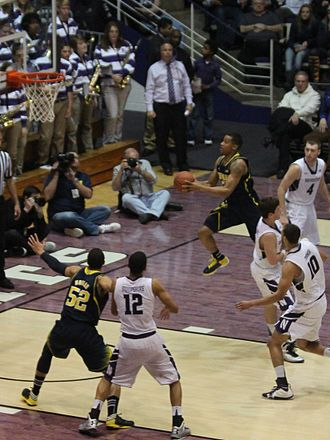 Trey Burke - Burke penetrating to attempt a layup for the 2012–13 Michigan Wolverines in the January 3 2012–13 Big Ten Conference season opener against Northwestern at Welsh-Ryan Arena