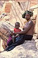 ASC Leiden - W.E.A. van Beek Collection - Dogon daily life 13 - A young mother with child, on the rock at the house of the anthropologist, Tireli, Mali 1980.jpg