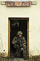 A Czech soldier provides cover while fellow soldiers conduct unified land operations training during exercise Combined Resolve 2013 at the 7th Army Joint Multinational Training Command's Hohenfels Training Area 131115-A-BS310-276.jpg