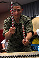 A Japan Ground Self-Defense Force soldier takes part in a taiko drum performance for an assembly of U.S. and Japanese soldiers during a cultural exchange event at Friendship Hall, Camp Itami, Osaka, Japan 120127-A-OX951-095.jpg