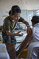 A Philippine Army medical provider injects medicine into a local Filipino inside the makeshift hospital at the Tacloban Air Field, Philippines, Nov. 15, 2013 131115-M-UY543-116.jpg