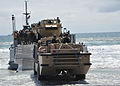 A U.S. Navy Light Amphibious Resupply Cargo vehicle prepares to drive aboard an Improved Navy Lighterage System during a maritime prepositioning force training scenario June 12, 2013, in Coronado, Calif., as 130612-N-OP638-120.jpg