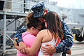 A U.S. Sailor assigned to the guided-missile destroyer USS Michael Murphy (DDG 112) embraces family and friends before leaving Joint Base Pearl Harbor-Hickam, Hawaii, for an independent deployment to the western 141020-N-QG393-018.jpg