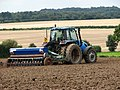 A farmer seeding on his field.jpg