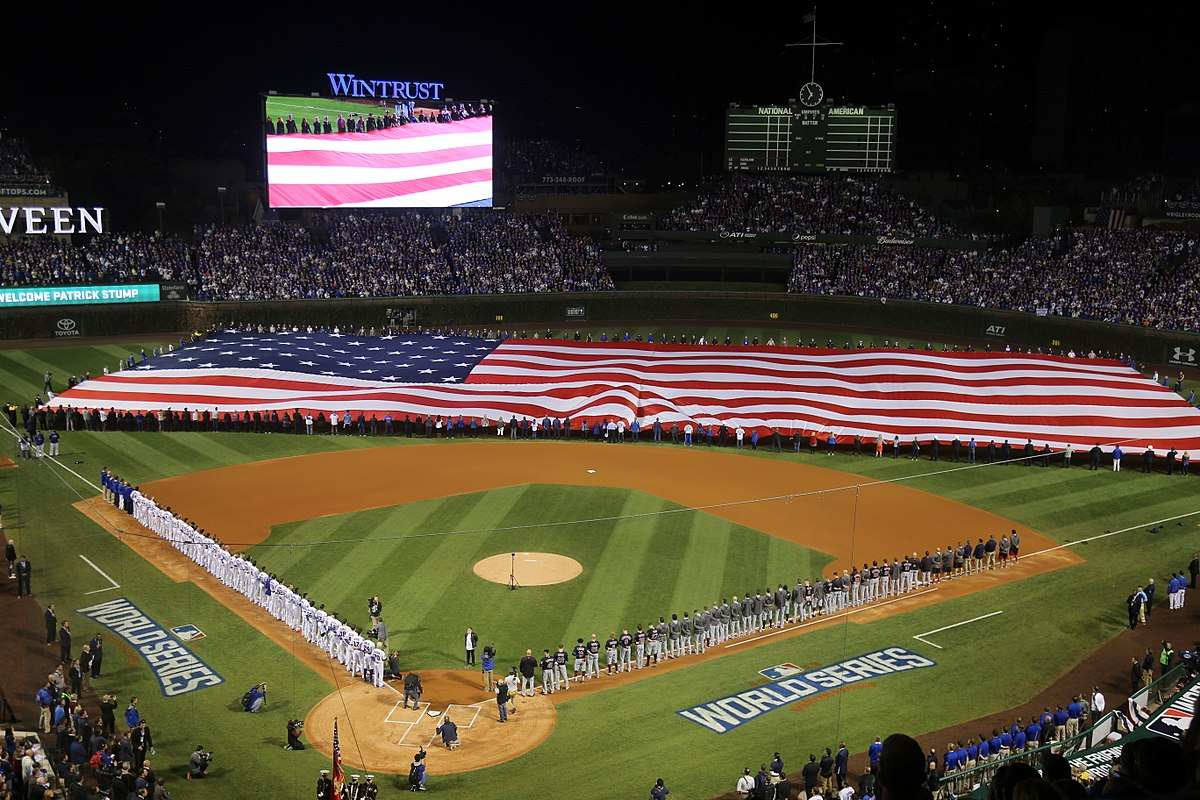 A giant American flag is unfurled at Wrigley Field before World Series Game 3, October 28, 2016 (Cubs won the Series, remember?) Will 2017's World Series push into November for the first time? Wikimedia Commons image