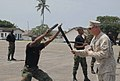 A member of the Ghana Army 2nd Engineer Battalion practices baton techniques with a U.S. Marine Corps military policeman during a nonlethal force demonstration June 26, 2013, in Accra, Ghana, as part of exercise 130626-A-ZZ999-005.jpg