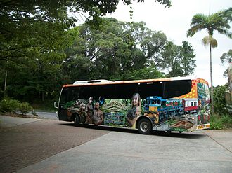 Tour bus service - A colourful tour bus at Kuranda, Queensland, Australia