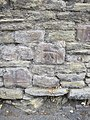 A weathered bench mark alongside Dinham - geograph.org.uk - 2535109.jpg