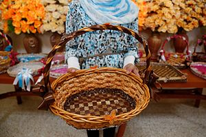 Micro-enterprise - A young Syrian refugee holds a basket that she decorated for sale.  Making and selling small crafts or clothes is a common form of micro-business for women.