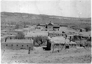 Abiquiú, New Mexico - Abiquiu church and plaza around 1920.