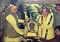 Acharya Rewa Prasad Dwivedi receiving Srivani Alankarana from Prime Minister Atal Bihari Vajpayee.jpg