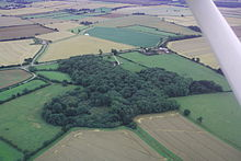 aerialview of woodland. One part of the wood is circular, with a central clearing