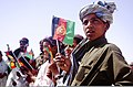 Afghan children wave flags during a celebration of the Islamic religious holiday of Eid al-Fitr in the Garmsir district of Helmand province, Afghanistan, Aug 110831-M-ED643-010.jpg