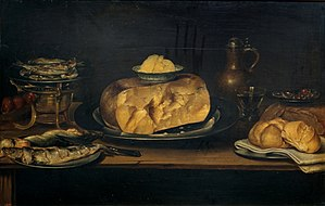 Alexander Adriaenssen - Still life of a table with crockery, cheese, sausage and fish