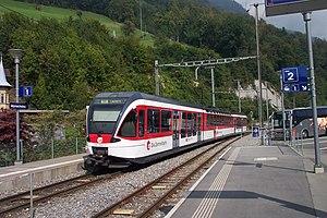 Alpnachstad railway station - Zentralbahn train departing the station