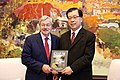 Ambassador Branstad greeted by Party Secretary Zhang Jiangting during his first visit to Qingdao. (29797886008).jpg