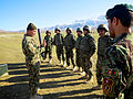 An Afghan National Army noncommissioned officer, left, instructs fellow Afghan soldiers on safety practices for the M224 60 mm mortar system during training in Baghlan province, Afghanistan, Dec. 23, 2013 131223-A-CR409-072.jpg