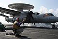 An officer launches an E-2C Hawkeye..jpg