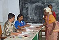 An old lady voter registering her name at a polling booth of Theni Parliamentary Constituency, during the 5th and final phase of General Election-2009, in Samayanallur, Tamil Nadu on May 13, 2009.jpg