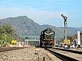Andal based WDG3A ^14681 awaits at Narangi station to give pass to 15718 Mariani-Guwahati Intercity Express. Chunsali hill is in the backdrop - Flickr - Dr. Santulan Mahanta.jpg