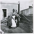 Anna and Viola Brand with the family dog in backyard, Seattle, 1901 (MOHAI 9112).jpg