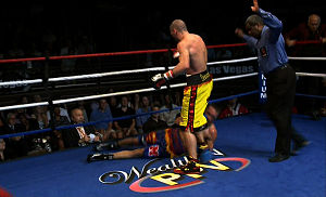 AWE (TV network) - Anthony Mundine stands over Bronco McKart on Fight Night, July 14, 2012