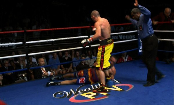 """Anothy Mundine stands over Bronco McKart on July 14th, 2012 during WealthTV's """"Fight Night"""""""