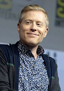 Anthony Rapp smiling and looking slightly to the side.