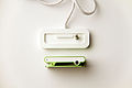 Apple iPod Shuffle second generation green top view and dock connector top view.jpg