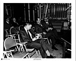 Armstrong and others sitting in chairs.jpg