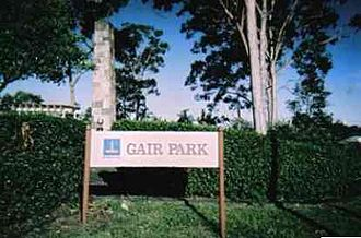 Vince Gair - Cenotaph behind hedges, Gair Park