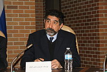 Azizi speaking in Torento 2.jpg
