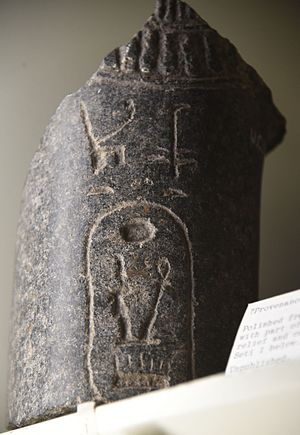 Seti I - Basalt fragment. Part of a necklace, in relief, is shown together with a cartouche of Seti I. 19th Dynasty. From Egypt. The Petrie Museum of Egyptian Archaeology, London
