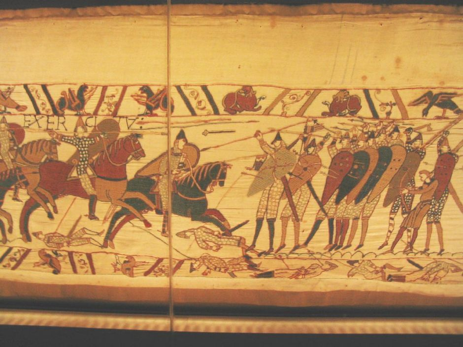 Norman cavalry armed with lances attacks the Anglo-Saxon shield wall. Notice the dominance of the spearmen in the front line of the formation. In the back of the formation there is one warrior armed with a battle-axe, one archer and one javelinman. There are javelins in mid-flight and slain soldiers pierced with javelins on the ground Bayeux Tapestry 4.jpg