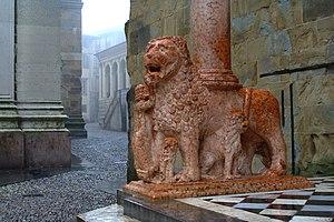 Red Verona marble - Column-bearing lions in Red Verona Marble. Santa Maria Maggiore, Bergamo.