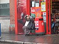 Big Issue Seller in Dublin fixing scarf.jpg