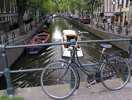 Bicycles have almost no carbon footprint compared to cars, and canal transport may represent a positive option for certain types of freight in the 21st century. BikesInAmsterdam 2004 SeanMcClean.jpg