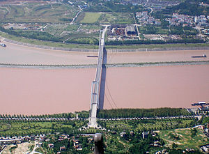 Taipingxi - Xiling Bridge and a section of Taipingxi Town. Looking north; the Yangtze flows to the right; Sandouping in the foreground, Taipingxi in the background