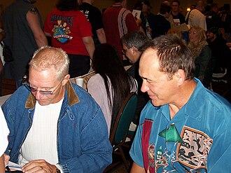Bobby Heenan - Heenan (left) signing autographs alongside Larry Zbyszko.