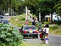 Boda boda riders with a passenger.jpg