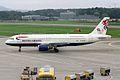 "British Airways Airbus A320-111 G-BUSC Sydney 2000 ""Teaming up for Britain"" (24700949540).jpg"